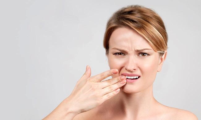 Шатаются зубы у взрослого  — причины и лечение