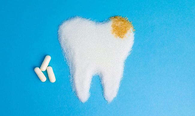 Болит зуб под коронкой: что делать и в чем причина?
